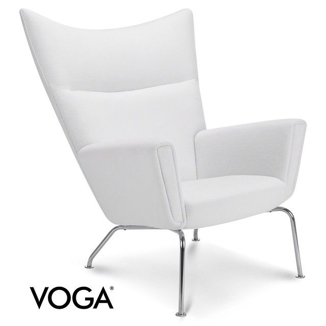 Curling up in this chair with a cup of tea and a good book would be a perfect fall activity, don't you think? You can buy it at www.voga.com #furniture #interior #design #wegner #fall #teatime #voga