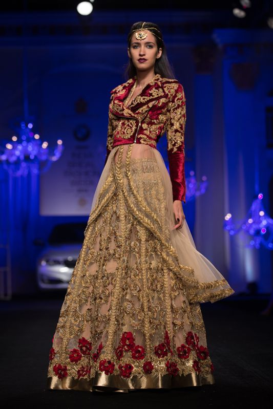 Velvet red and gold lehnga with jacket blouse and rose border by Falguni & Shane Peacock. More here: http://www.indianweddingsite.com/bmw-india-bridal-fashion-week-ibfw-2014-falguni-shane-peacock-show/