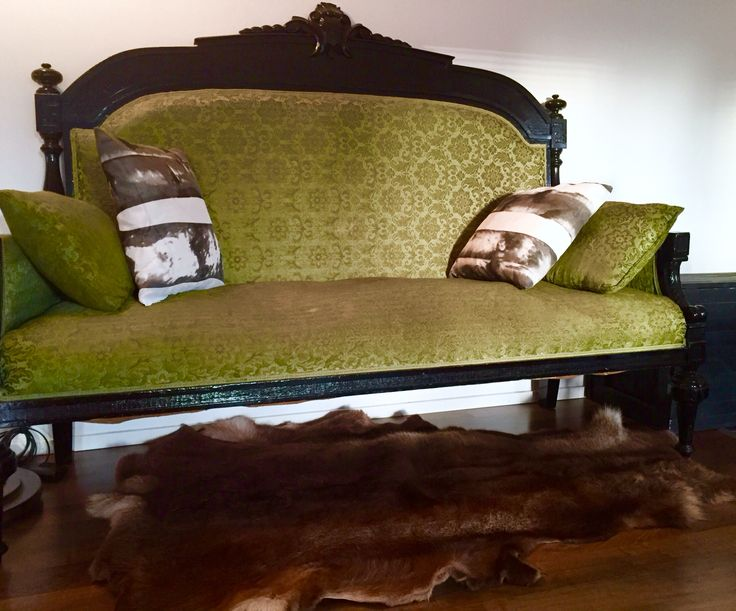 Family heirloom sofa and reindeer hide. Birch cushions made from Ikea curtain fabric.