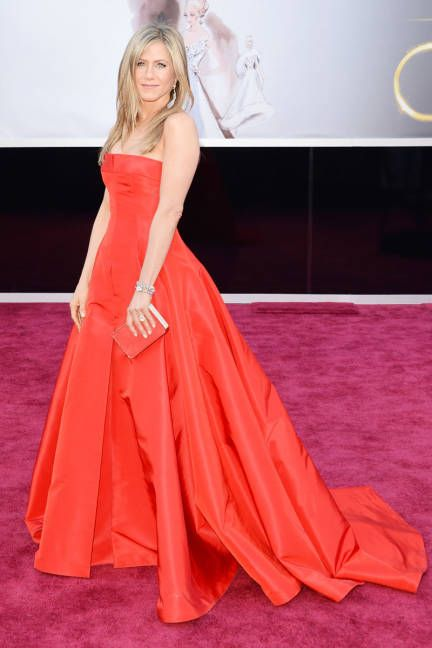 Jennifer Aniston in bright red Valentino couture at the Oscars