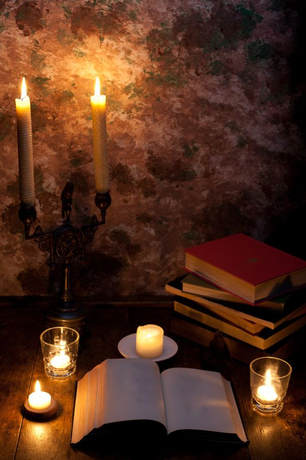 'Books and Candlelight' by Michi Termo.