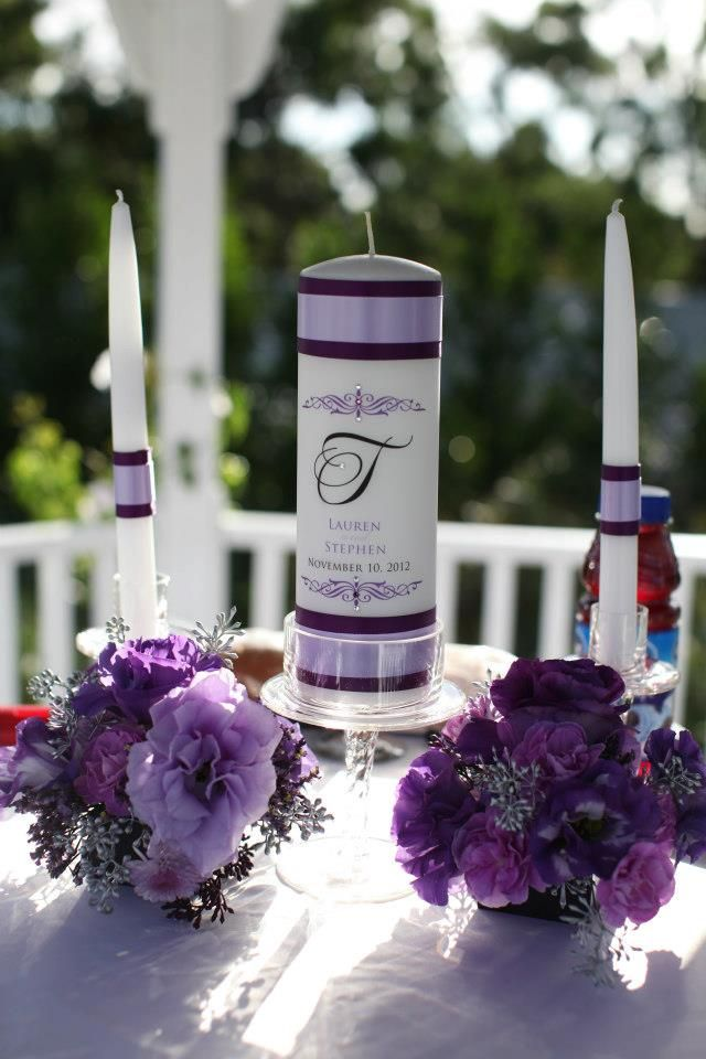 Purple Wedding. Unity Candles. Purple Flower arrangements for Unity Candles. Used on cocktail tables after Wedding Ceremony - Simply Regal by Julie