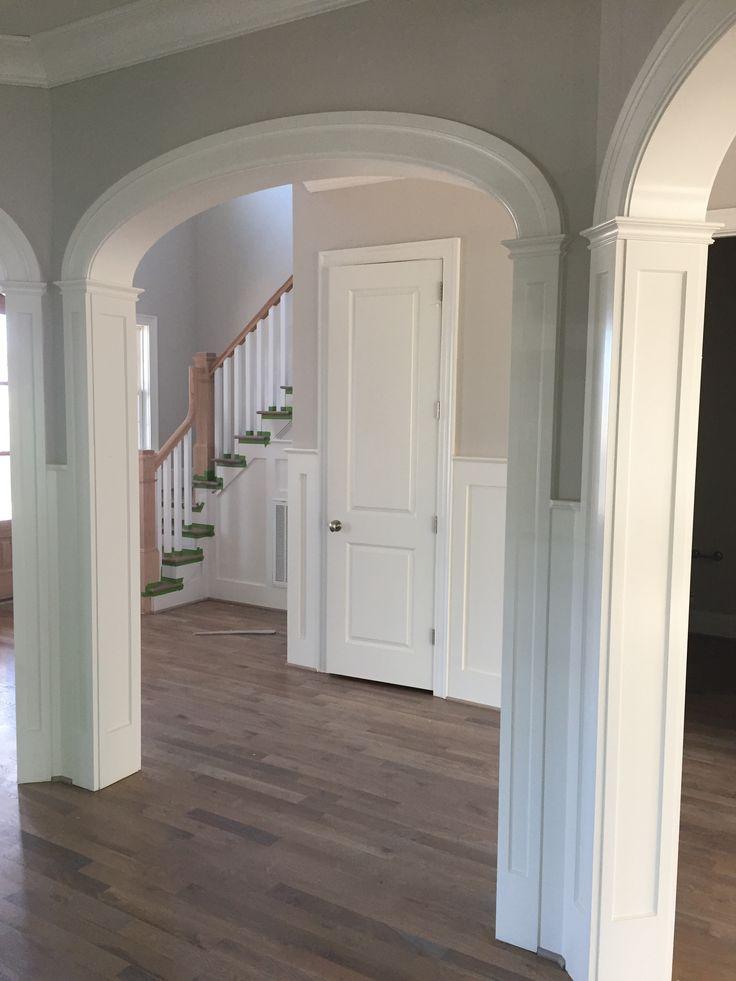 Panel Columns Underneath An Elliptical Arch Doorway