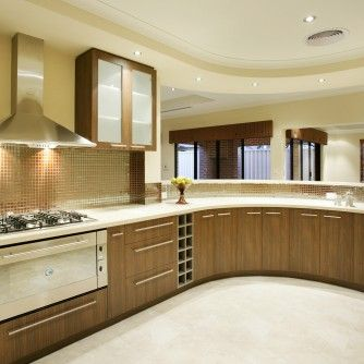 Interior Beige Ceramic Flooring Tile Shiny Golden Backsplash Tiles Brown Wooden Cabinets Stainless Steel Chimney Wall Cabinets Beige Cclassy Open Kitchen Design Ideas Kitchen Ideas That Inspire You with Multi-Functional Furniture