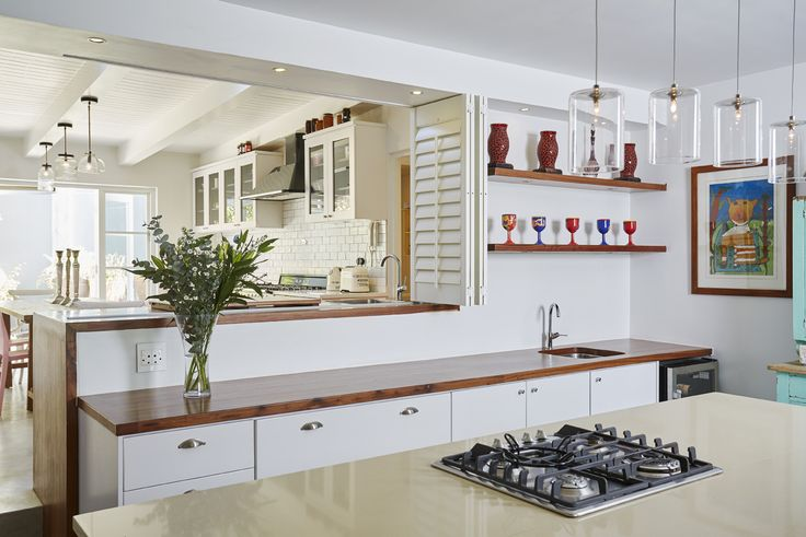 A double volume kitchen. The kitchen is a place for family time, laughter and memories...it has become a living space.   #kitchen #pink #family #memories #food