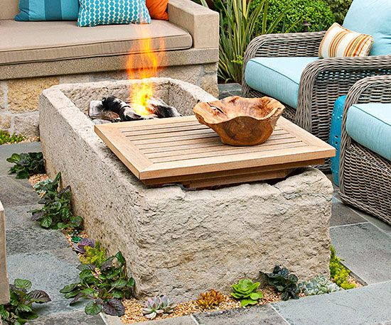 "Horse trough ""coffee table"" makes a fire-pit on one side, drink cooler on the other side."