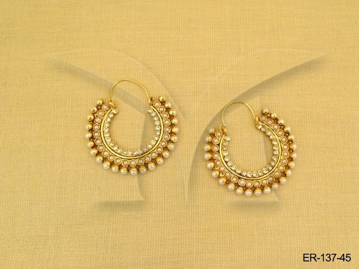 Simple - Sober - Elegant! Enhance your ethnic look with these 'Hoop Diamond and Pearl Polki Earrings'.