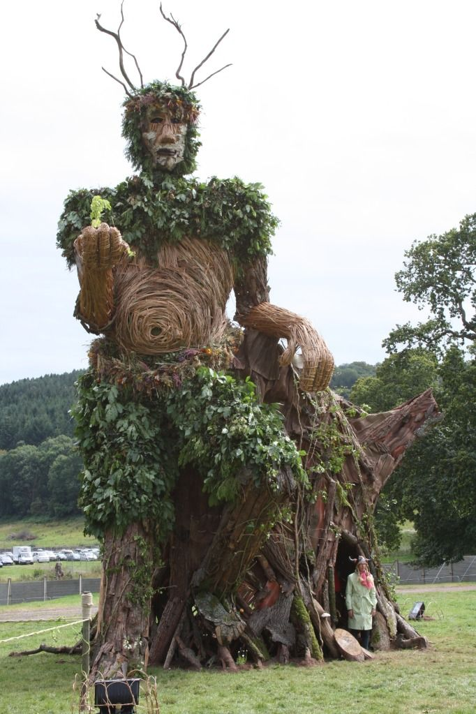 The Greenman Festival 2011  Things one one bumps into at a festival.  (A Giant Wicker Green Man standing by a viking)  Picture by IansMadHouse