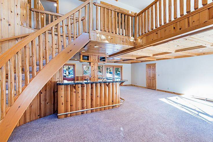 Custom mountain pine woodwork in this home backing to forest lands and cross country ski trails #skiinskiout #mountainhome #Livingroom #Tahoehome