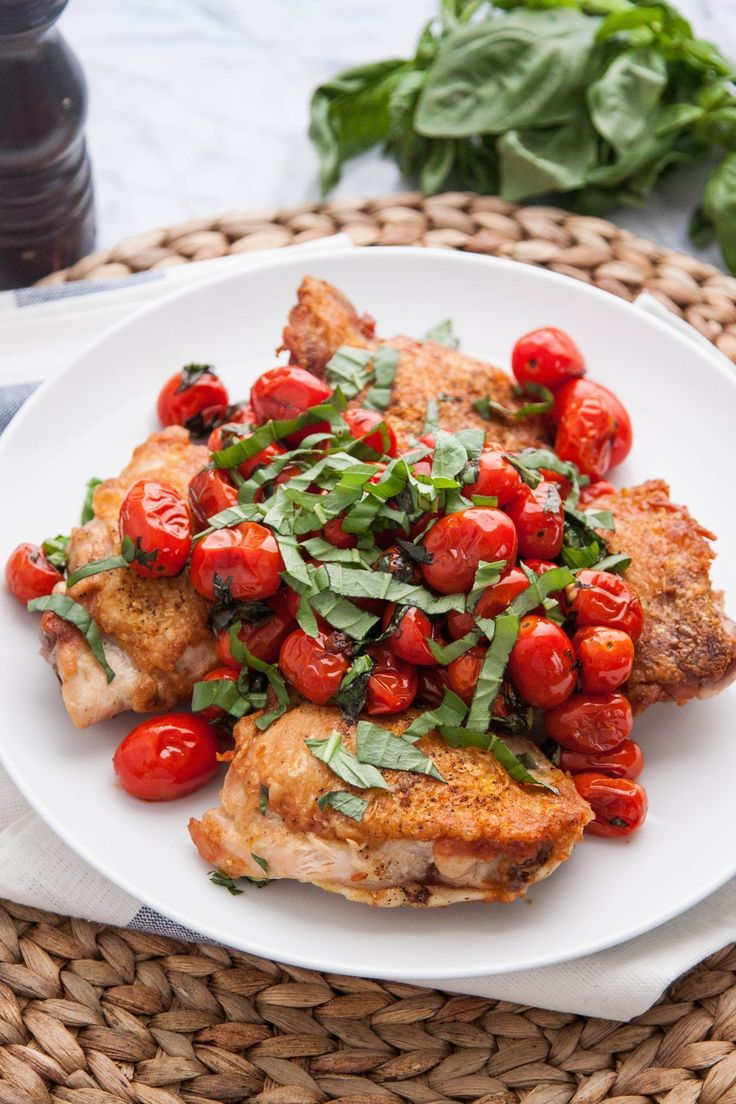 Recipe:  Pan-Seared Chicken Thighs with Blistered Tomatoes & Basil  — Weeknight Dinner Recipes from The Kitchn
