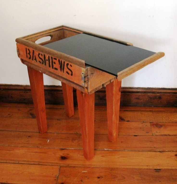 Cape Town's Iconic 'Bashew Crate' is transformed into a quirky side table, with reclaimed timber legs and a black coloured sliding glass top – perfect to store anything from your magazines to your TV remote controls.