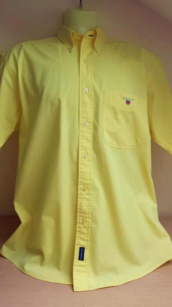 Gant Shirt Size L Men's Yellow Button DownMens Gant Shirt  This Shirt  is  so  cool & stylish!   includes spare buttons 1 chest pocket, Gant USA Logo  to chest Pleat Loop to back  Fabric: Cotton
