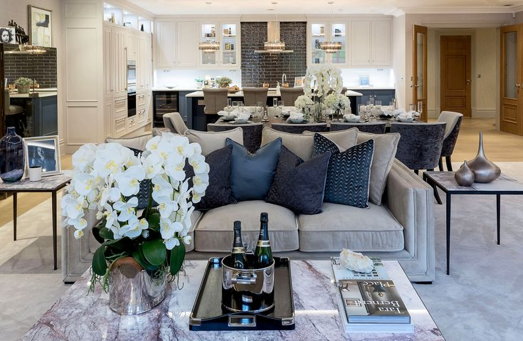 This chic Eichholtz coffee table and matching side tables in bianco lilac marble with bronze finish add stylish flair to our Millgate apartment design, whilst the paint-glaze inspired 'crackle' Zoffany cushions emit a sense of pure luxury.