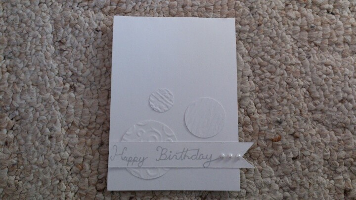 Easy cards to mask produce using white on white but embossing the circles