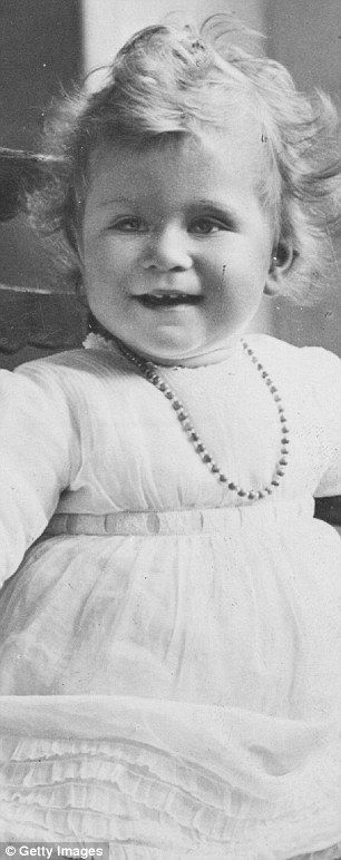 The young Princess Elizabeth pulls a cheeky grin for the camera in 1928...