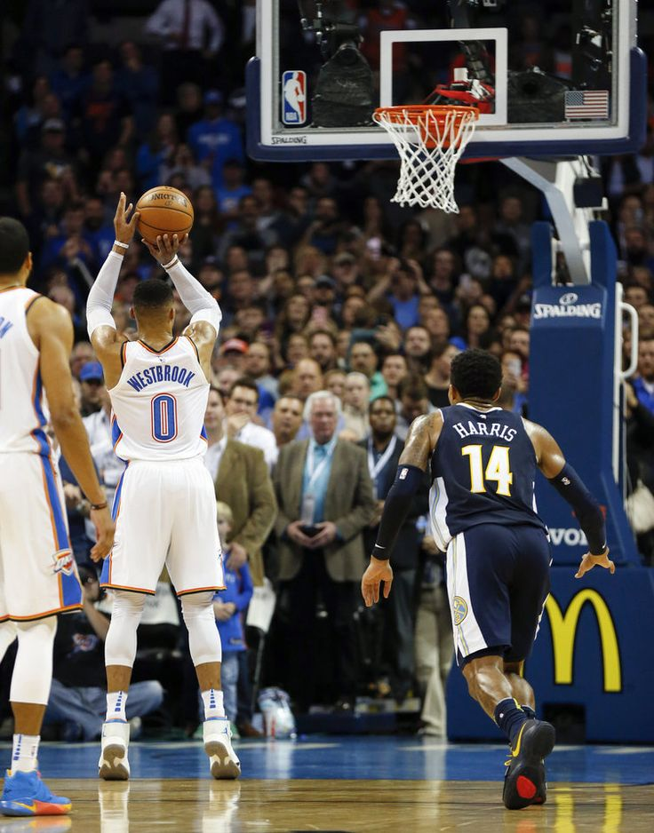 Oklahoma City\'s Russell Westbrook (0) shoots his second foul shot on the Thunder\'s last possession during an NBA basketball game between the Oklahoma City Thunder and the Denver Nuggets at Chesapeake Energy Arena in Oklahoma City, Monday, Dec. 18, 2017. Westbrook missed the foul shot, and Oklahoma City won 95-94 after Denver missed its last shot. Photo by Nate Billings, The Oklahoman