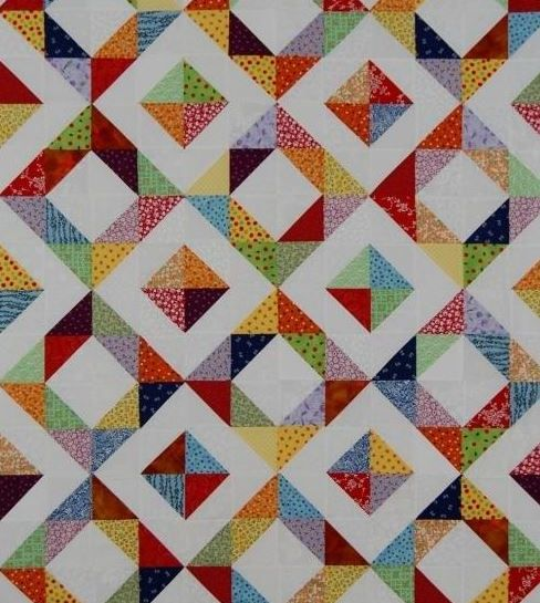 Half square triangles in a charm quilt, very nice quilt in many colors