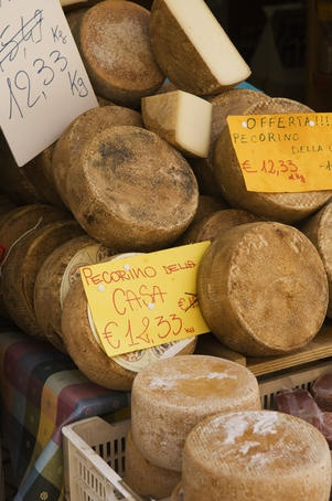 Cheese on display in town square, Castiglione del Lago. - Castiglione del Lago, Umbria