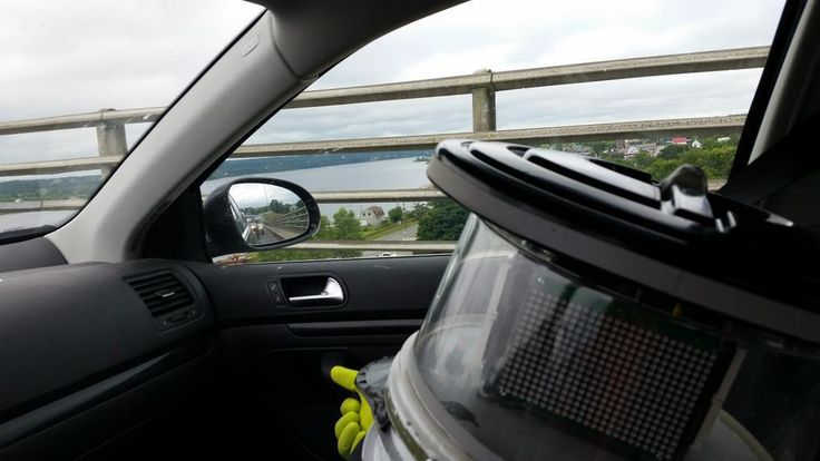Retweeted by hitchBOT | Jean-Pierre Brien @BrienPierre • July 28 • @hitchBOT is enjoying the view over the bridge, even though it isn't covered