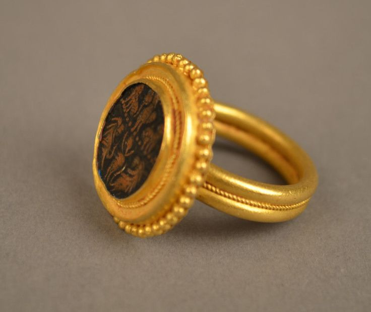 Gold ring with lions in stone c 13th century