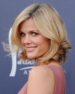 Brooklyn Decker's hair is a nice length -- I think I'd need the front of my hair to be at least chin length to pull off a short cut. by kari