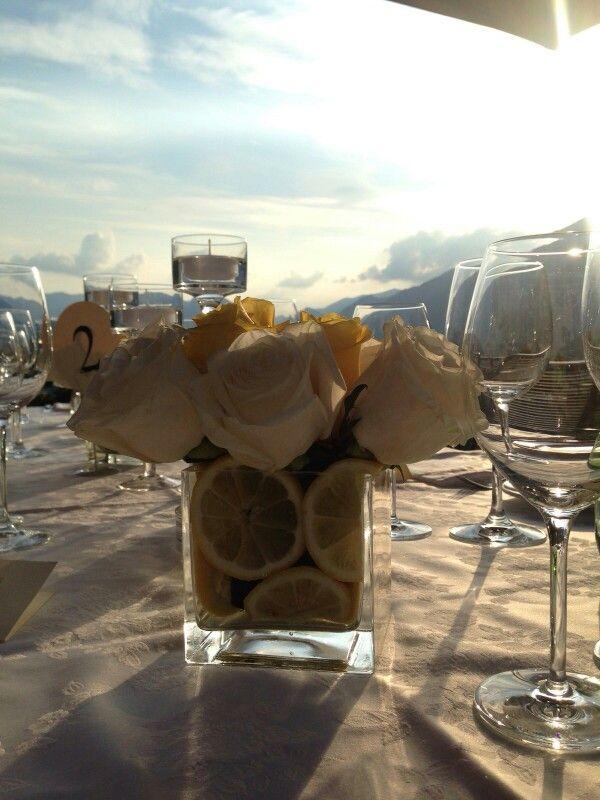 Cream roses and a mix of sparkling yellow roses with lemon #lakecomoweddingsandevents #lemonsetting #yellow #theme #Wedding