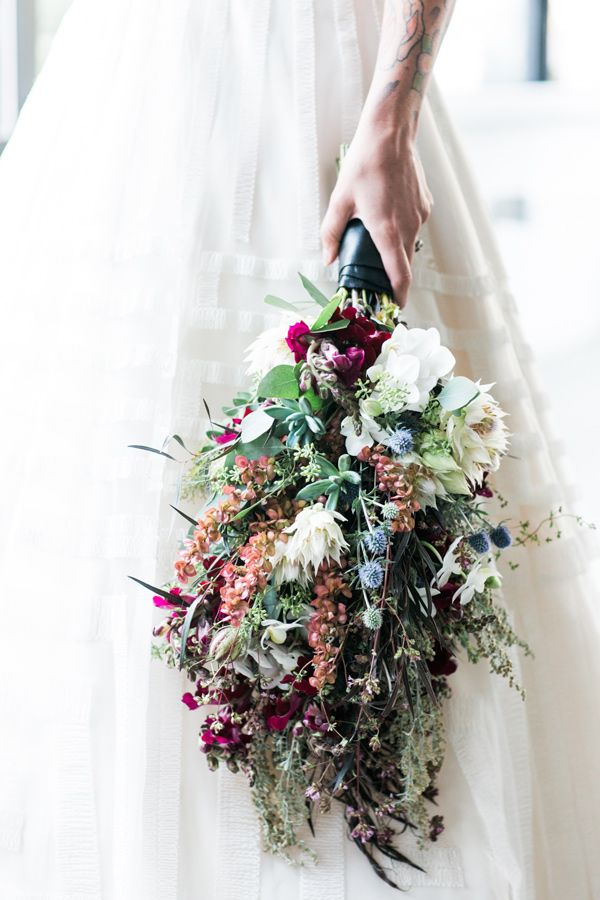 winter wedding bouquet - photo by Jessica Hill Photography http://ruffledblog.com/plum-toned-stained-glass-wedding