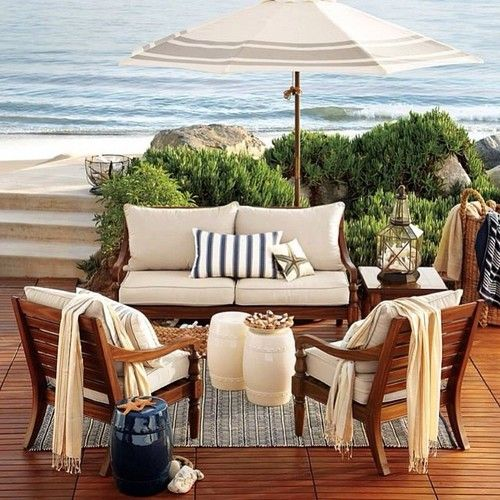 Teak. Tan cushions blue pillows.