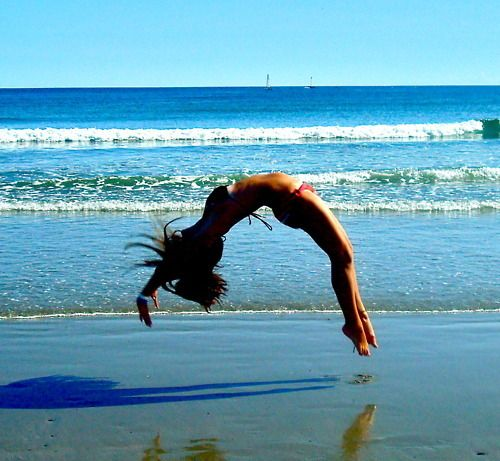 tumbling on the beach; suprisingly difficult when your feet and hands sink in and get stuck every time...