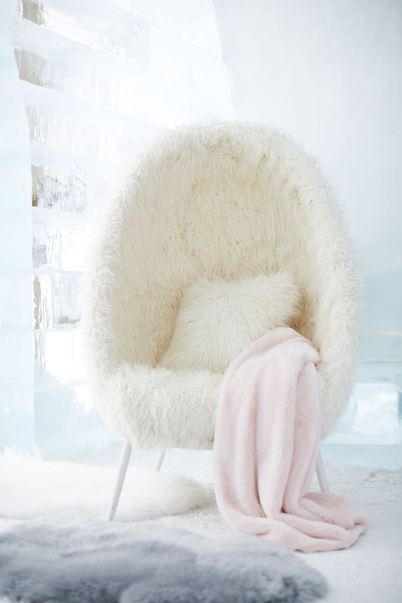 Everything looks so fluffy and comfy. All I want to do is fall into that chair:)