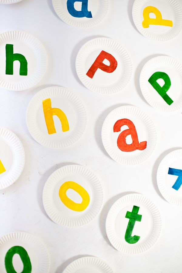 food color painted paper plates. just paint a number or letter or shape on a plate, toss a bean bag and Identify it