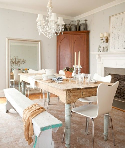 love the mirror leaning against the wall, the chandelier, and the bench. Just replace those chairs with some upholstered ones from Pottery Barn and strip the paint off the legs of the table.