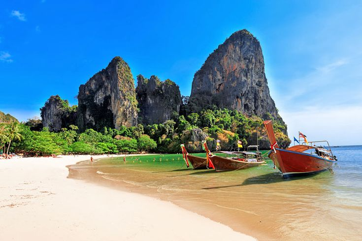 Longtail boats on #Railay Beach, #Krabi | Thai beaches that are even better than 'The Beach' | Weather2Travel.com #beach #travel #thailand #beachporn #bestbeaches