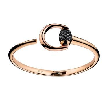 Best From Gucci this Horsebit Collection k rose gold bangle bracelet features black diamonds on