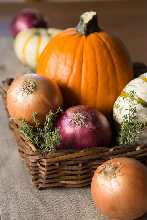 Thanksgiving centerpiece with pumpkins and onions