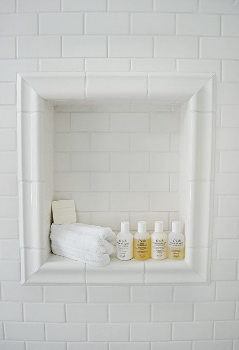 white subway tile bathroom | shower niche - white subway tile and chair rail trim