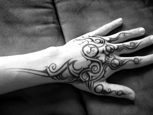 Tribal hand tattoo.