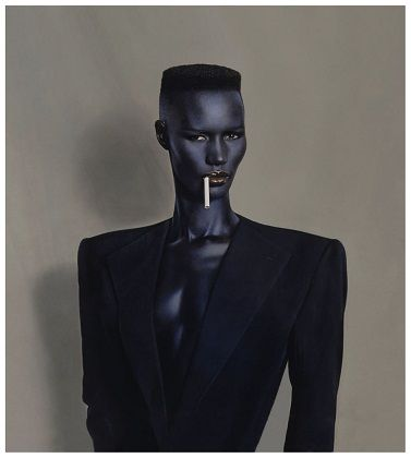"""In 1980, Jones adapted the emerging New Wave music style and adopted a stern, austere look, created in partnership with stylist Jean-Paul Goude.[9] She would also exemplify the so-called """"flat top"""" hairstyle in many of her concerts in the 1980s, which would become very popular, especially amongst black men."""