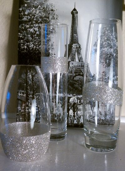 diy glitter vases.. Found a way to get the silver in the centerpieces