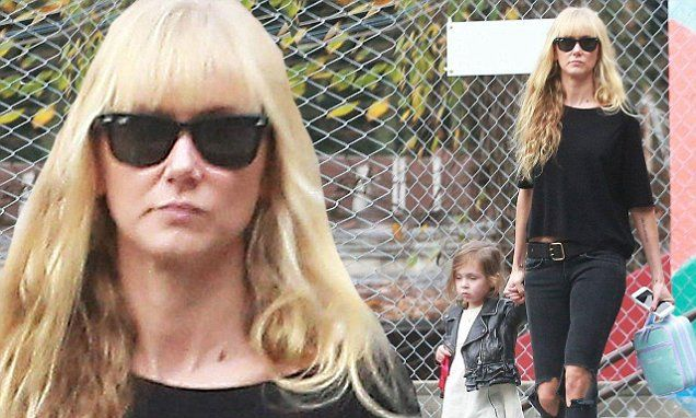 Kimberly Stewart sports edgy jeans as her daughter dons leather jacket