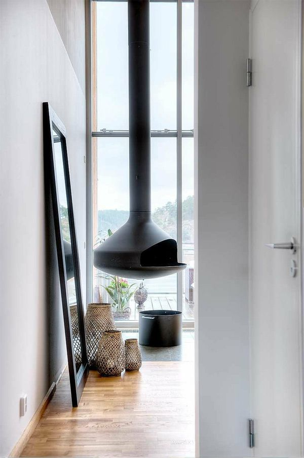 I just love those floating woodburning stoves!    Dreamy Modern Swedish Apartment