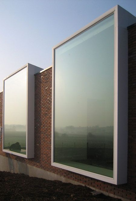 Nothing beats large windows. Notariaat by Belgian architects Atelier Vens Vanbelle.