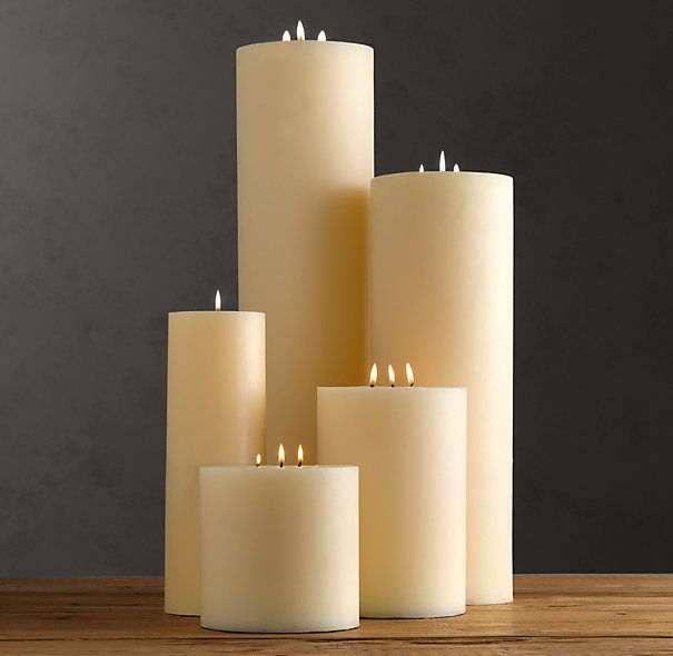 large ivory pillar candles for fireplace; could be for den too