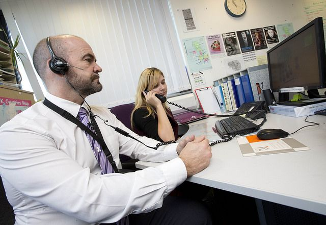 Chief Inspector Michael Montford listens to a call at Independent Choices. Men from GMP today, 25 November 2016, joined the rest of the world in standing up to violence against women by stepping out of their normal working routine in support of International White Ribbon Day. DCI Montford joined support charity Independent Choices, who run the Greater Manchester Domestic Abuse Helpline. www.gmp.police.uk