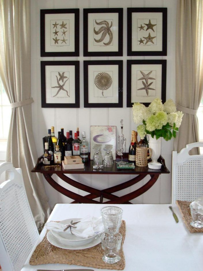 Design Ideas: Coastal Living Room In Elegantly Shabby. beach decor ideas. beach style dining room. framed coastal wall art. gray tied drapery. wooden tray table. white rattan dining chair. natural place mat.