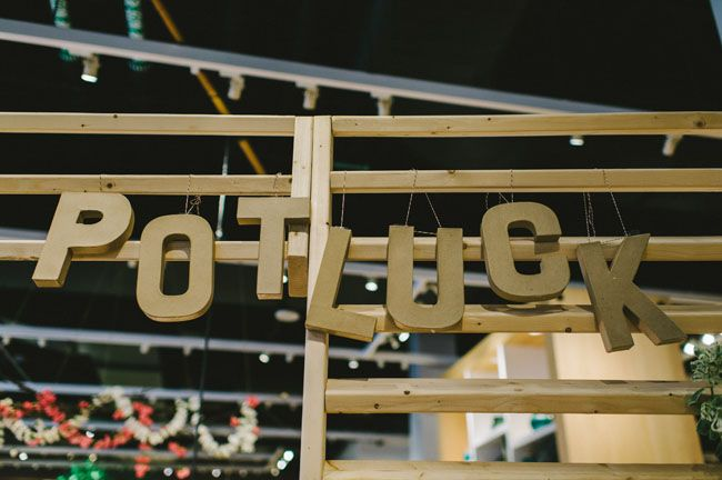 cheap spray painted cardboard letters hung chaotically