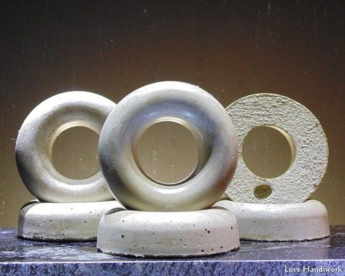 This is a rustic donut shaped cement paperweight. I have rubbed it with a dark wax to give it a more earthy look. There are 6 pictured. This listing is for ONE paperweight. Some have more air bubble