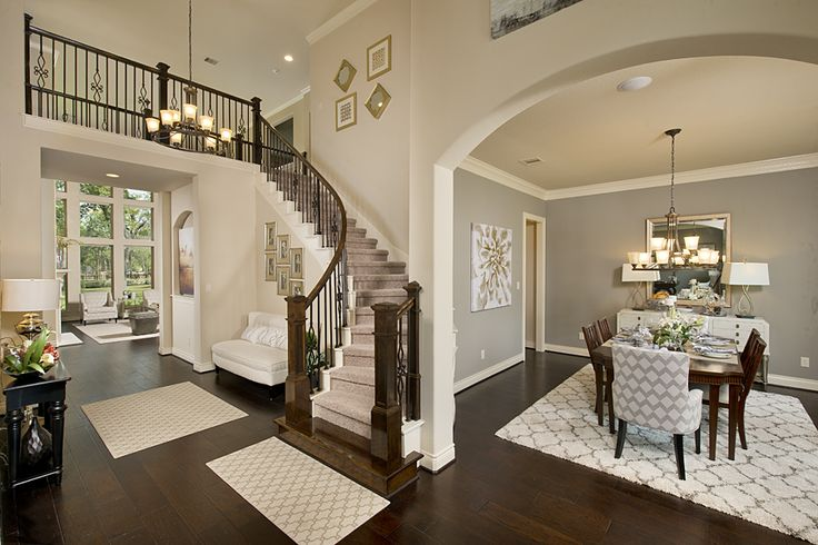 4931 sq ft model home foyer and circular staircase