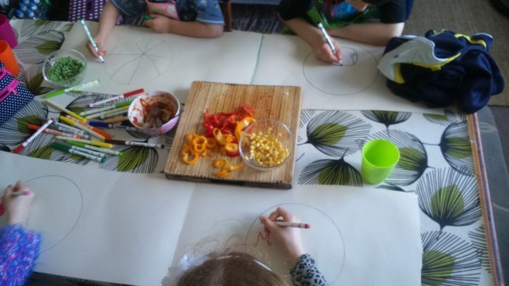 Allowing children to graze on snacks gives them an opportunity to try out new foods when there is no pressure to fill up. Here children are designing plates which will become their place mats
