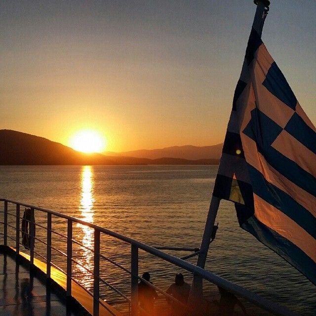 mariap280691 #greece #travel_greece #travelgreece #instagood #instahub #instatravel #world_union #wu_greece #insta_greece #gf_greece #screaming_shots #gf_daily #evia #aidipsos #edipsos #sunset #flag #sea #ferryboat #ferry #boat #sail http://instagram.com/p/r4J_qJPtUR/